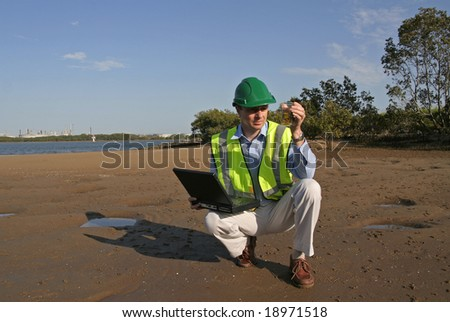 Image of a man checking the health of the environment. - stock photo