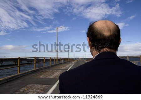 Image of a man from behind. - stock photo