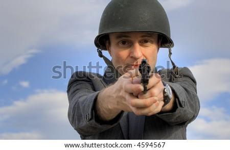 Image of a man in a suit (boss) firing a gun. - stock photo