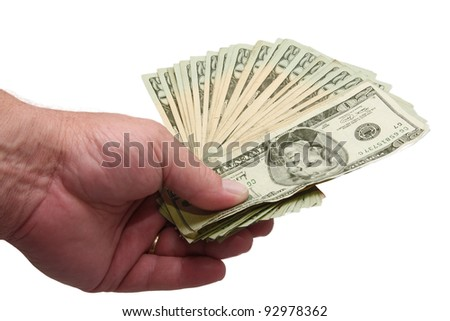 Image of a man's hand holding about $500 in twenty  dollar bills, isolated on white.