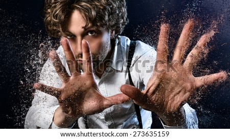 image of a man who performs magic with his hands - stock photo