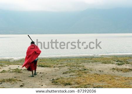 Image of a Masai in front of Empakai lake - stock photo