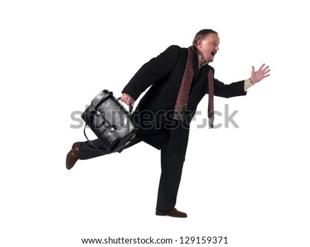Image of a mature businessman getting late at work