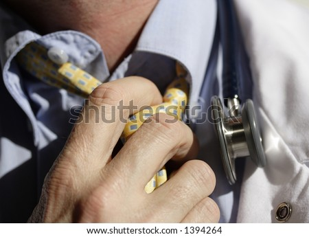 Image of a medical doctor loosening their tie at days end - stock photo