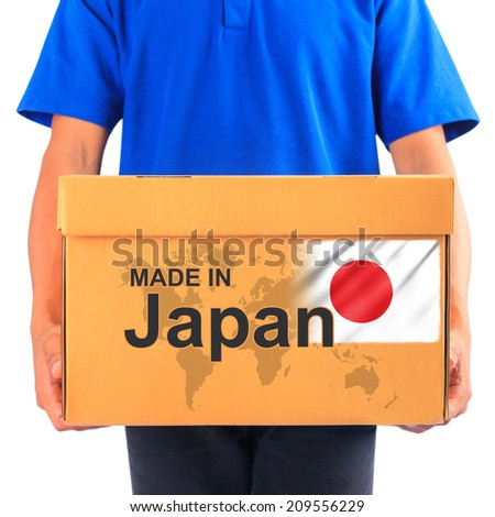 image of a messenger delivering holding a package with made in Japan - stock photo