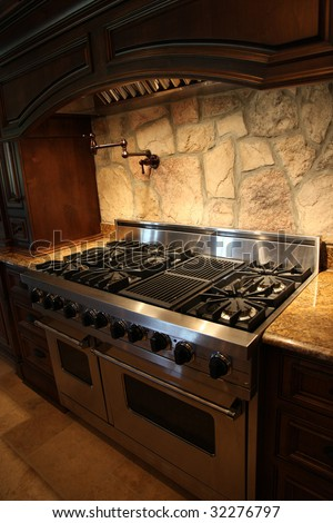 Image of a million dollar modern middle Tennessee Home. Gas stainless steel oven and stove. - stock photo