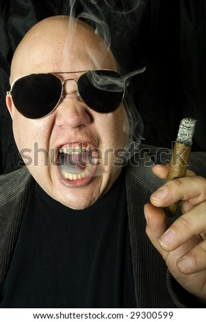 Image of a mobster, gangster, or boss. Harsh lighting for meaner look. - stock photo