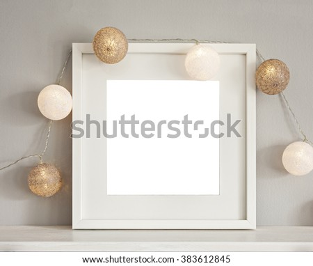 Image of a mockup scene with white frame and light baubles.  - stock photo