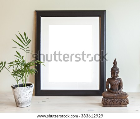 Image of a mockup scene with wooden frame, plant and buddha statue.  - stock photo