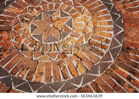 Image of a mosaic pattern with terracotta bricks.   - stock photo