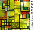 Image of a multicolored stained glass window with irregular block pattern in a hue of green, square format - stock photo