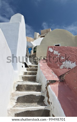 Image of a narrow street at Oia village of Santorini island in Greece - stock photo