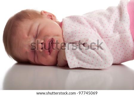 Image of a newborn baby in discomfort. - stock photo