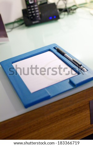 image of a note pad on the table in the hotel - stock photo