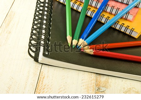 image of a notebook and pencil closeup - stock photo