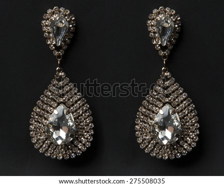 Image of a pair of diamond  earrings in black background - stock photo