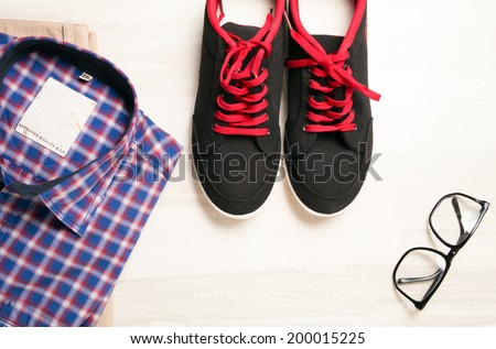 image of a pair of shoes and blue checked shirt