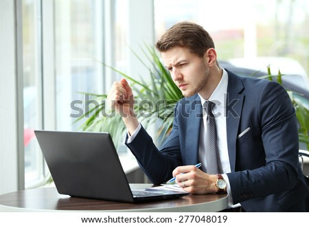 image of a pensive businessman in a cafe - stock photo