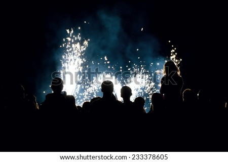 Image of a people in front of a fireworks - stock photo