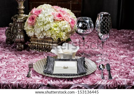 Image of a place setting at a wedding on pink - stock photo