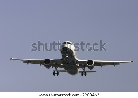 Image of a plane from the front at LAX.  Either landing or taking off.