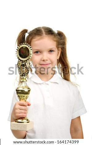 Image of a proud young girl holding her trophy. - stock photo