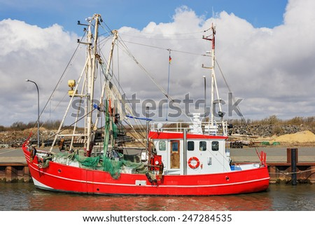image of a red fishing boat in northern Germany - stock photo