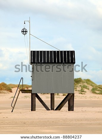 Image of a refugee shed on the beach - stock photo
