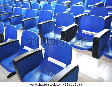image of a row of chairs in a waiting room - stock photo