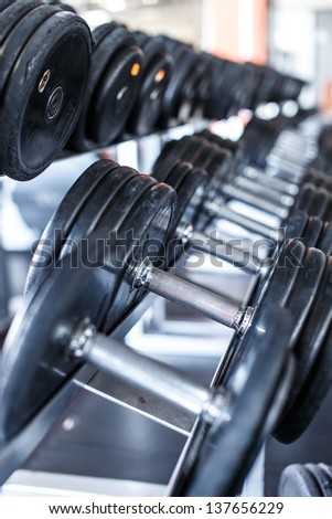 Image of a row of dumbbells