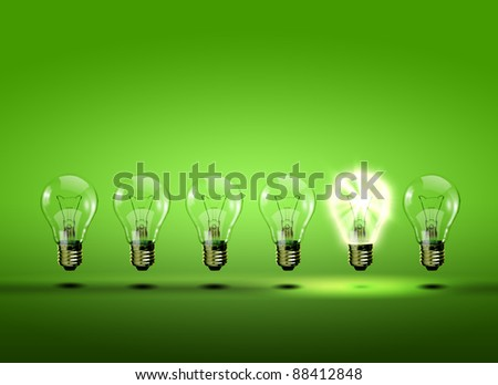 Image of a row of electric bulb with one different from the others - stock photo