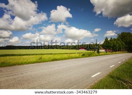Image of a rural landscape road. Scania, Sweden.  - stock photo