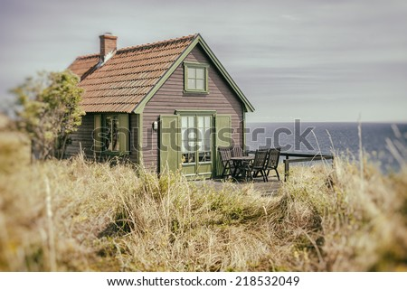 Image of a rustic seaside cottage.  - stock photo