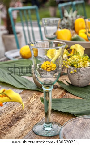 Image of a rustic table setting for a garden dinner party. - stock photo