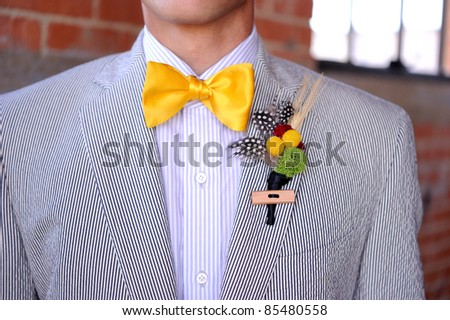 Image of a Seersucker Suit with yellow bowtie and boutonniere - stock photo