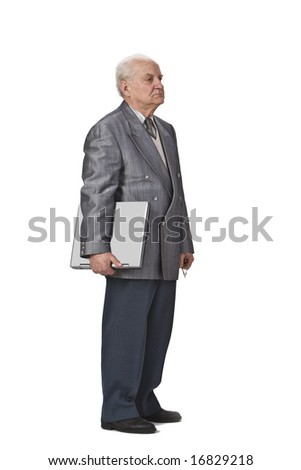 Image of a sehior man holding a laptop and standing-up against a white background,side view.