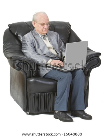 Image of a senior man siting in an armchair and using a laptop,isolated against a white background.