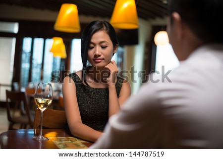 Image of a shy yet adorable girl being on a date with her boyfriend