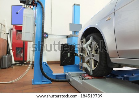 Image of a similarity collapse equipment in a car repair garage - stock photo