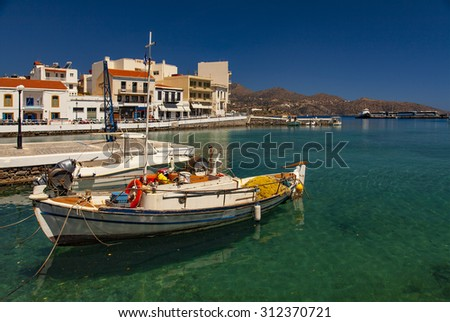 Image of a small fishing boat harbour in Agios Niklaos. Crete, Greece. - stock photo