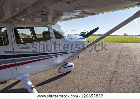 Image of a small private airplane waiting for take off - stock photo
