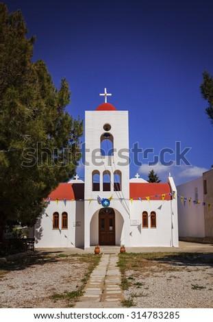Image of a small white chapel in the village of Makrigialos. Crete, Greece.  - stock photo