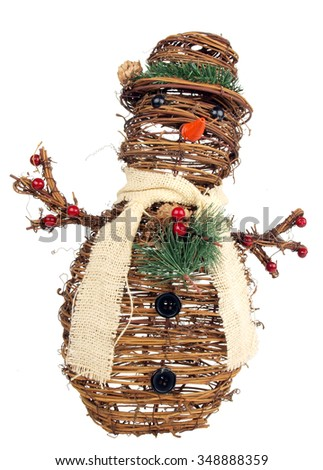 image of a snowman ornament made out of twigs for the xmas holiday on a white background - stock photo
