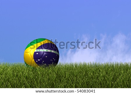 Image of a soccer ball with the flag from Brazil on grass. - stock photo