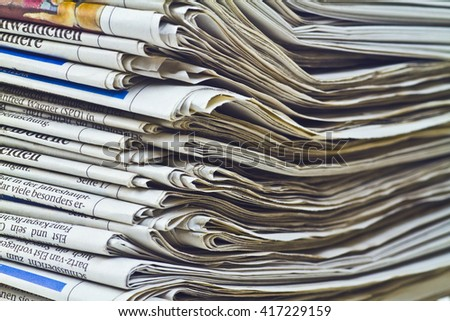 Image of a stack of german newspaper  - stock photo