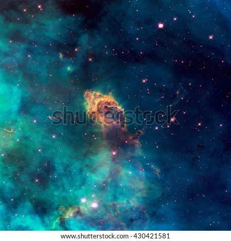 Image of a stellar jet in the Carina Nebula, imaged by Hubble's WFC3/UVIS detector. Universe filled with stars, nebula and galaxy. Elements of this image furnished by NASA. - stock photo