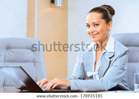 image of a successful business woman, working with laptop