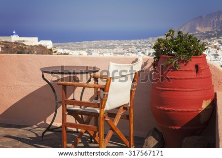 Image of a sun terrace with a beautiful view of Santorini Island, Greece.