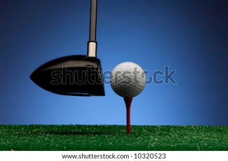 Image of a teed up golf ball about to be hit by wood