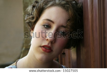 Image of a teenage girl looking lonely and depressed - stock photo